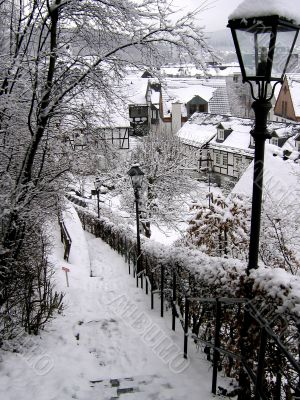 White-snowy stairs in a old little german town