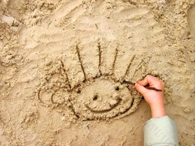 Funny smiley on wet sand