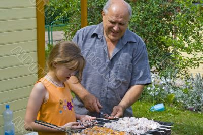Grandfather, granddaughter and kebab