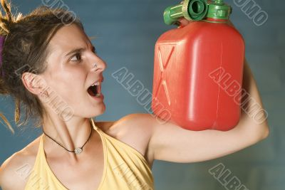 woman looks at petrol can