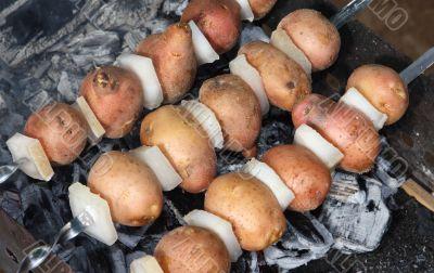 Potato with fat on coal