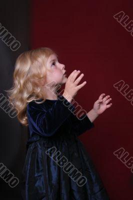 happy little girl in party dress