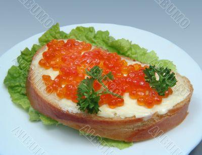 Sandwich with salmon caviar
