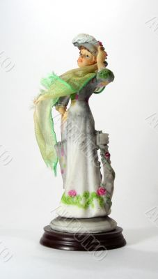 Figurine of a lady with green scarf