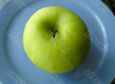 Apple on blue plate