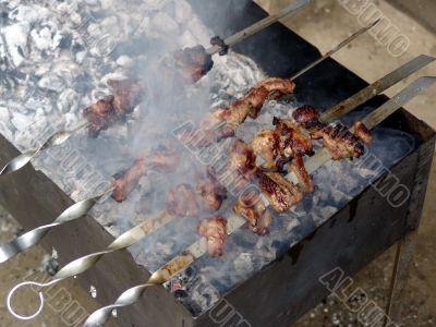Meat is fried on bonfire