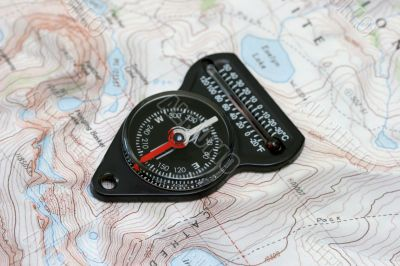 Compass over hiking map