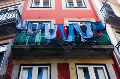 Jeans dried on a balcony