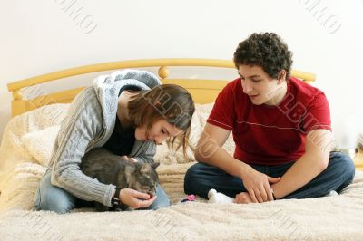 Sweet Couple Playing With Their Cat