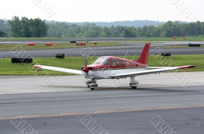 Red and White Plane on Runway