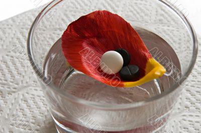 three tablets on petal