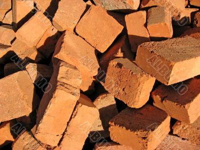 Pile of a cracked red bricks