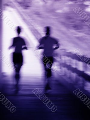 Artistic blur of a running couple
