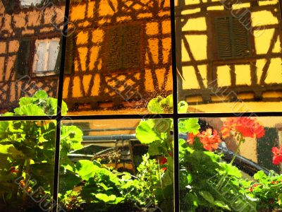 Old alsacian house through a window