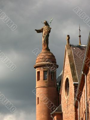 Statue on the roof of a cathedral