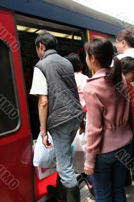 People boarding a train