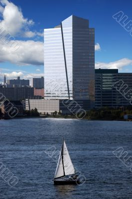 skyscraper with sail boat and waterview