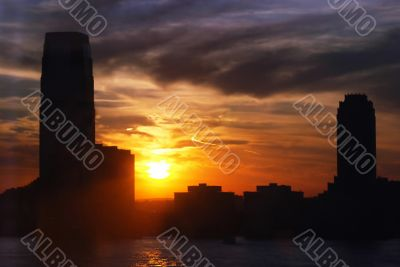 skyline and skyscrapers with water and setting sun
