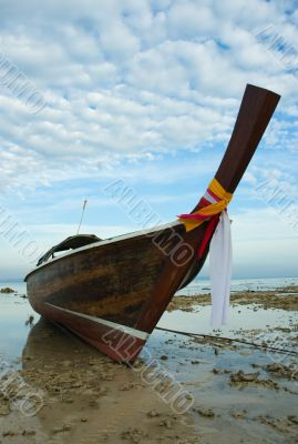 longtail boat in low tide, thailand