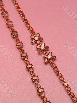 Two jewelry bracelets with garnets