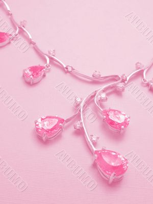 Rosy background with necklace