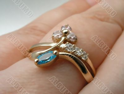 Golden ring on a female hand