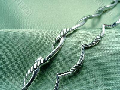 Bracelets on green drapery