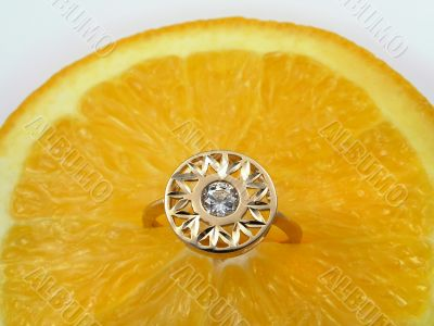 Orange and diamond ring