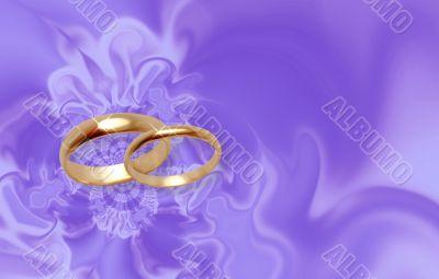 Wedding rings on lilac