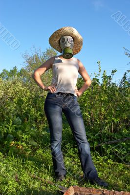 woman in gas-mask at garden work