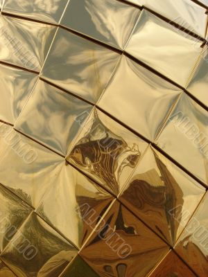 Golden church cupola mirroring surface