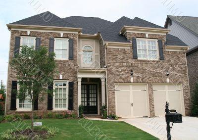 Brown and Tan Brick House
