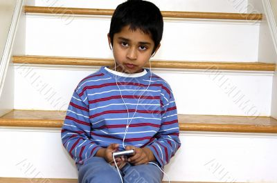 Kid listening to music