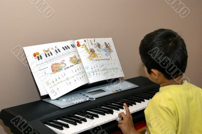kid practicing piano