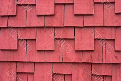 weathered red shake siding background