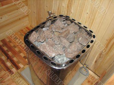classic wooden dry sauna inside hot stones