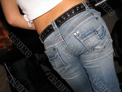 Rump attractive young girl in blue jeans