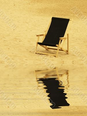 beach chair reflecting in water