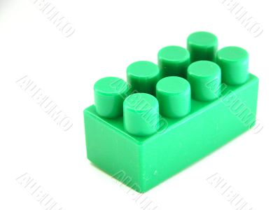 the green on white plastic toy building block