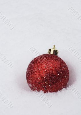 christmas bauble in white snow