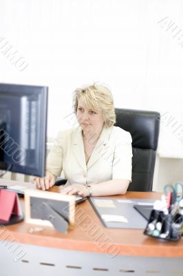 Mid-life business woman look at camera