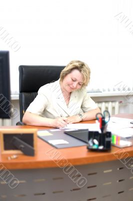 Mid-life business woman write document #1