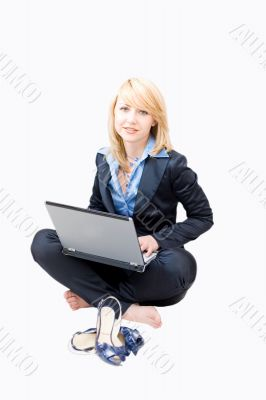 Woman working on a laptop and take off shoes