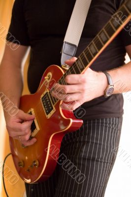 Musician play on guitar #1