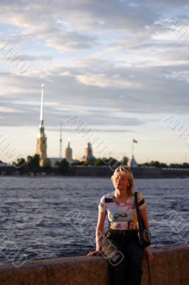 Girl sitting on canal border in Saint Petersburg