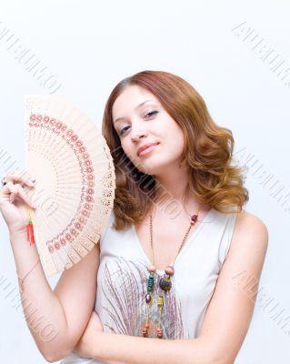 Girl brush away face by fan #1