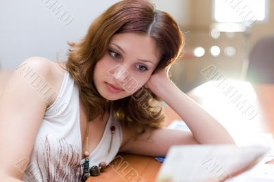 Attractive girl reading document in consultative room