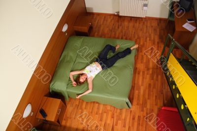 Woman lie on bed. View from above