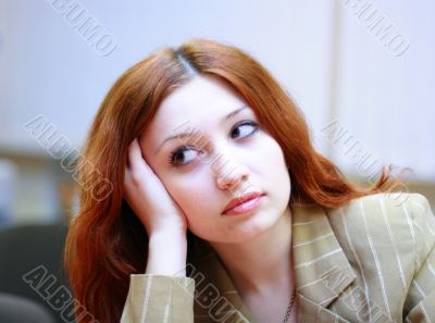 Girl with reddish hair in office #2