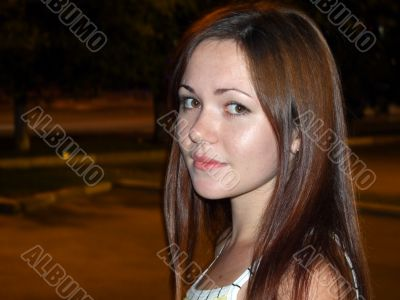 portrait of a beautiful young girl at night